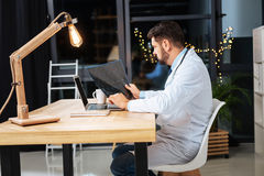 Smart experienced doctor studying an X ray photo. Medical diagnosis. Smart experienced male doctor studying an X ray photo and putting a diagnosis while having a royalty free stock photos