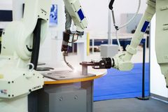 Assembly line with the robotic arms. stock photos