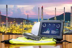 Smart factory - Rugged computers tablet in front of oil refinery