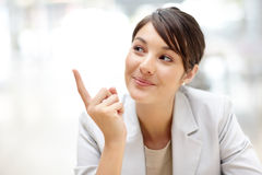 Smart female executive pointing at copyspace Royalty Free Stock Photos