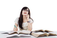 Smart female learner thinking an idea Royalty Free Stock Photos
