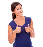 Smart female in purple dress with ok sign Royalty Free Stock Photos
