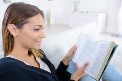 Smart female reading book Royalty Free Stock Images