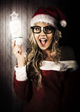 Smart Female Santa Claus With Christmas Idea royalty free stock photography