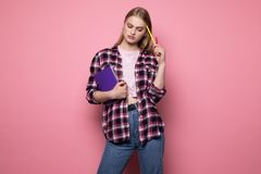 Smart female student with blonde hair wearing casual clothing stock photo