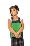 Smart flicka med den stora gröna boken Fotografering för Bildbyråer