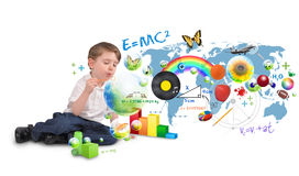 Smart Genius Boy Blowing Scinec and Art Bubbles. A young boy is sitting on a white isolated background blowing bubbles of science, nature, math and art. Use it Stock Photo