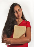 Smart girl. 11 year old girl, holding a book close to herself Stock Images