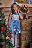 Smart girl in a blue dress Royalty Free Stock Image