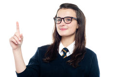 Smart girl draws the attention of teacher Stock Photos
