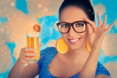 Smart Girl with Orange Juice and Orange Slice Earr Stock Photography