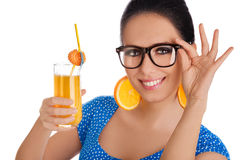 Smart Girl with Orange Juice and Orange Slice Earrings White Background Royalty Free Stock Photography