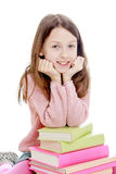 Smart girl put her elbows on a stack of books Royalty Free Stock Photography