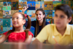 Smart Girl Raising Hand And Asking Question At School Stock Image