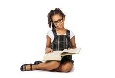 Smart girl reading a big green book Royalty Free Stock Images