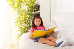 Smart girl reading Stock Photography