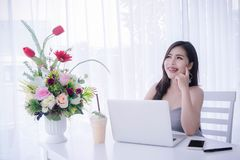 Smart girl`s using laptop and happy time on work , smile and lau. Ghing time work , workingwomen get think about work Stock Photos