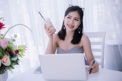 Smart girl`s using laptop and happy time on work , smile and lau. Ghing time work , workingwomen get think about work Stock Image