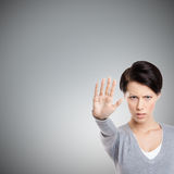 Smart girl shows stop gesture, close up Stock Photography
