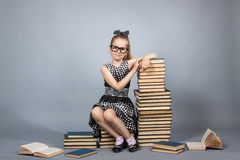 Smart girl with a stack of books. Royalty Free Stock Image