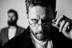 Smart glance. Accessory for smart appearance. Now i see everything. Attentive glance. Picky smart inspector. Man. Handsome bearded guy wear eyeglasses. Eye royalty free stock photography