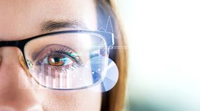Smart glasses and augmented reality concept. Woman wearing moder spectacles. royalty free stock photo