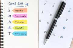 Smart goals setting acronyms on the notebook with calendar Stock Image