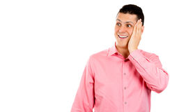 A smart good looking young man surprised , hand on cheek Stock Photography