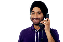 Smart guy answering the phone call Royalty Free Stock Images