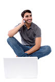 Smart guy communicating through cellphone Royalty Free Stock Image