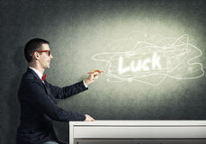 Smart guy draw on wall Royalty Free Stock Images