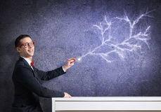 Smart guy draw on wall Stock Photos