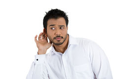 A smart guy excited to hear a juicy gossip, eavesdroping Royalty Free Stock Photos