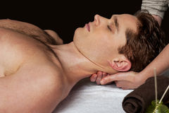 Smart guy getting spa treatment Royalty Free Stock Images