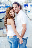 Smart guy with girlfriend at harbour Royalty Free Stock Photo