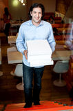 Smart guy holding pizza boxes Royalty Free Stock Photos