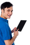 Smart guy holding touch pad Stock Image