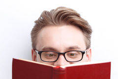 Smart guy involved in reading Royalty Free Stock Image