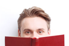 Smart guy involved in reading Stock Photography