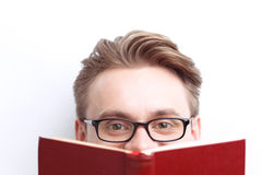 Smart guy involved in reading Royalty Free Stock Photos