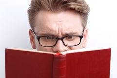 Smart guy involved in reading Stock Photo