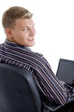 Smart guy with laptop looking at camera Royalty Free Stock Images