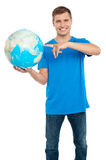Smart guy pointing at the globe Stock Photo