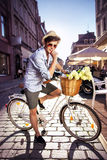 Smart guy riding a retro bike Stock Photo