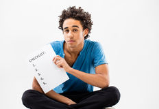 Smart guy shows a check list on a sheet Stock Photo
