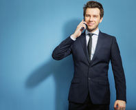 Smart guy talking by the cell phone Royalty Free Stock Photos