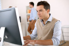 Smart Guy Working In Office Royalty Free Stock Photo