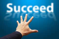 Smart Hand grab the word Succeed Stock Photography