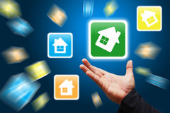 Smart hand hold the house icon Stock Images