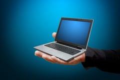 Smart hand hold laptop Stock Photo